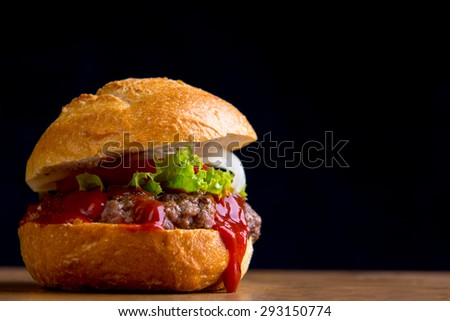 home made hamburger with meat, salad, onion, tomato and ketchup - stock photo