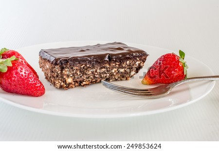 Home made Matzot chocolate cake and strawberry on white  plate for Passover holidays. - stock photo