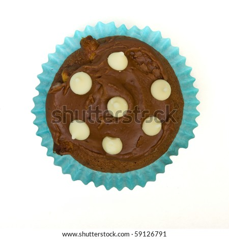 Home made milk chocolate cupcake with white chocolate drop decoration. - stock photo