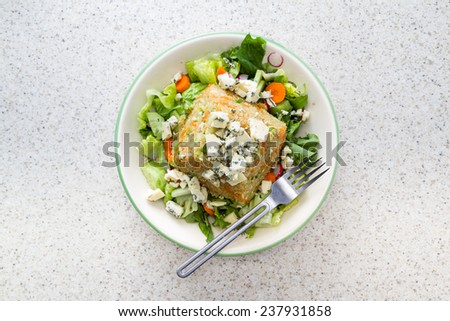 home made quinoa salad with fresh organic ingredients and bleu cheese on top - stock photo