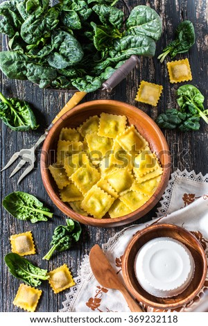 Home-made ravioli or tortelli with spinach and ricotta cheese - stock photo