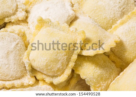 home made ravioli with flour - stock photo