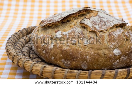 Home made rye and wheat bread in a basket - stock photo