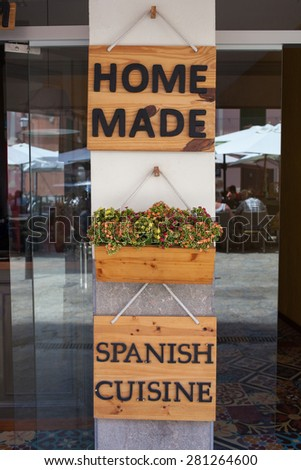 Home made spanish cuisine sign on entrance of restaurant - stock photo