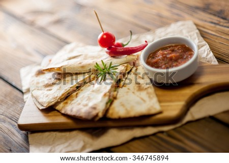 Home made tacos on wooden background with sauce - stock photo