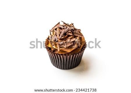 Home made whole chocolate muffin cupcake with chocolate icing, isolated on white background - stock photo