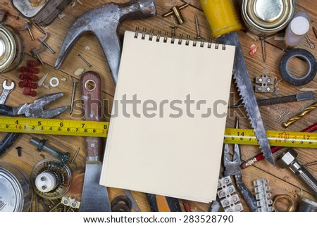 Home maintenance - An untidy workbench full of dusty old tools and screws with space for text. - stock photo