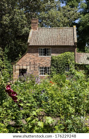 Home of Captain Cook moved from England to Fitzroy Gardens in Melbourne Australia by Russell Grimwade. Cottage garden has been cultivated in the rear of the building - stock photo