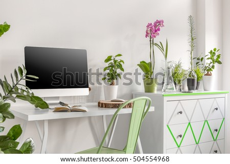 office flower pots. home office area with computer commode and flower pots orchids