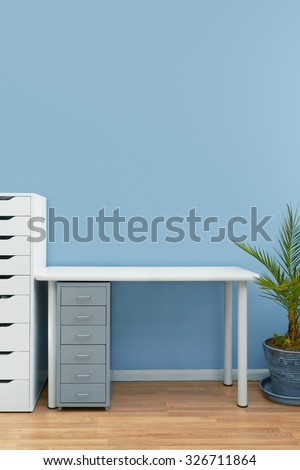 Home office interior set up with a blank computer screen to add copy - stock photo