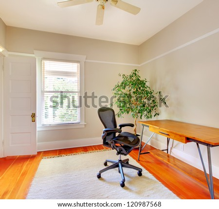 Home office room interior with desk and beige walls. - stock photo