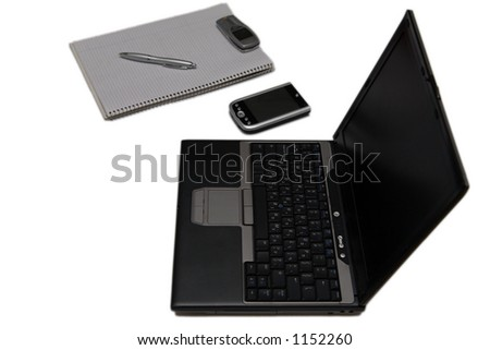 Home office setup - laptop, PDA, paper isolated on white