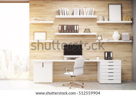 home office with light wood panels large writing table with workstation and multiple shelves with