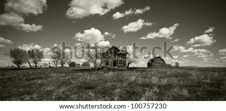Home on the Prairie - Black & White wide angle image of a retired farm in Easter South Dakota. - stock photo