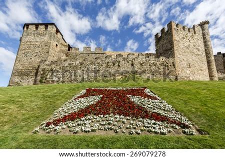 Home or main entrance of Templar castle in Ponferrada, the Bierzo, Spain. Detail public garden with the cross tau - stock photo