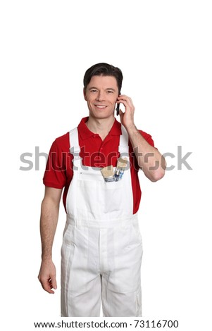 Home painter standing on white background with telephone