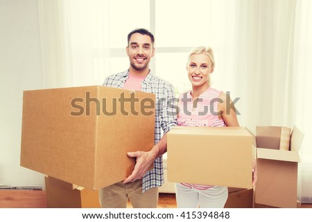home, people, repair and real estate concept - smiling couple with big cardboard boxes moving to new place - stock photo