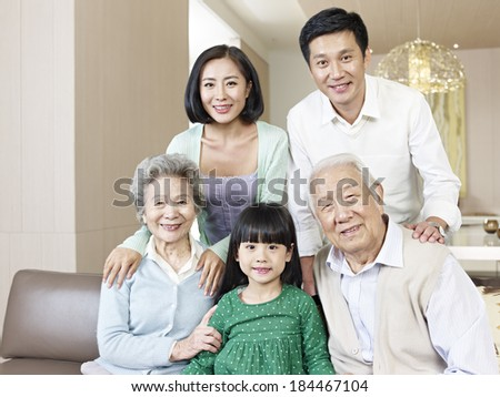 home portrait of a three-generation asian family - stock photo