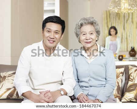 home portrait of asian mother and son - stock photo