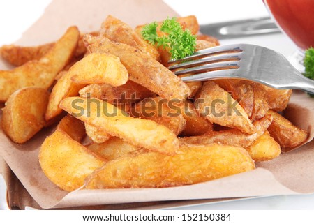 Home potatoes on tracing paper on tray isolated on white