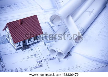 Home project in blue and architecture plans - stock photo