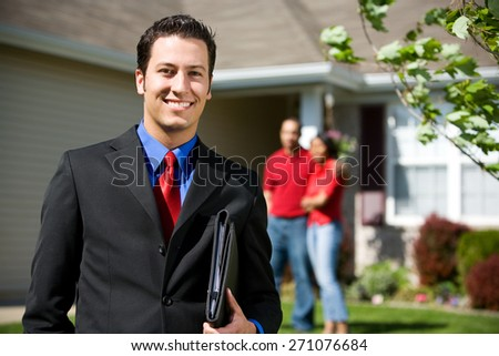 Home: Real Estate Agent Ready to Sell Home - stock photo