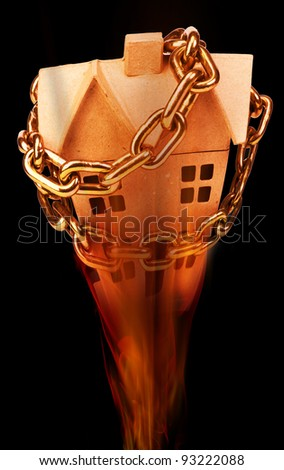 Home Real Estate Chained Up and Burning. - stock photo
