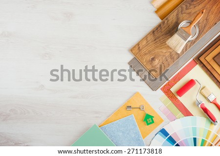 Home renovation and do it yourself concept with home construction and repair tools on wooden surface, top view - stock photo
