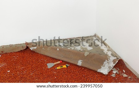 Home renovation, carpet remove in a room - stock photo