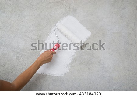 Home renovation. Painting the walls in white color
