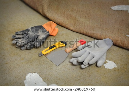 Home renovation, tools for carpet remove in a room - stock photo
