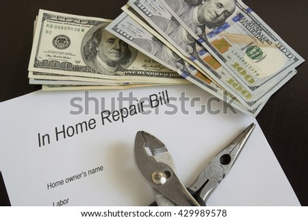 Home repair bill with large sums of money/Home Repair Cost/Plies rest on an invoice with large sums of money. - stock photo