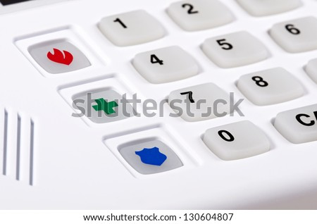 Home security alarm keypad, closeup of fire, police, and medical emergency buttons