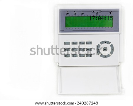 Home security alarm system on a white wall - stock photo