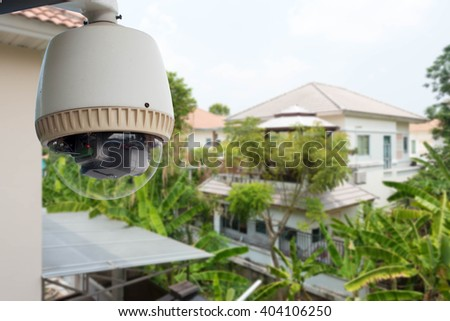 Home security concept, CCTV camera or surveillance operating in village - stock photo