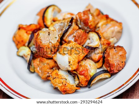 Home shish kebab with onion and aubergines on plate - stock photo