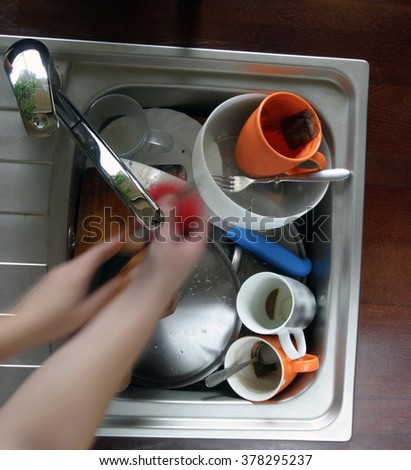 home sink full of dirty dishes