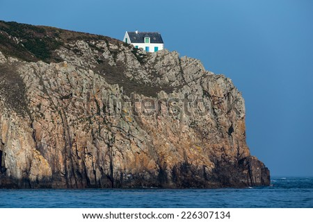 Home sitting on a high cliff in the Ushant island (aka Ouessant), Brittany, France - stock photo