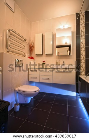 Home small bathroom together with a toilet in brown, beige, blue. Design, apartment, hotel, floor, building