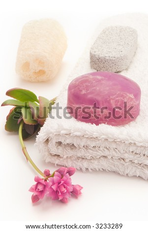 home spa with algae soap, loofa and towel - stock photo
