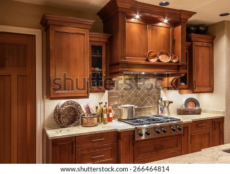 Home Stove Top Range and Cabinets in New Luxury House - stock photo