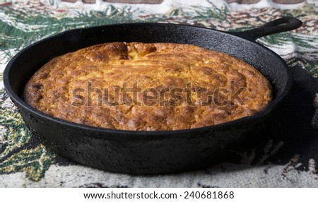 Home-Style corn bread in a cast iron skillet. - stock photo