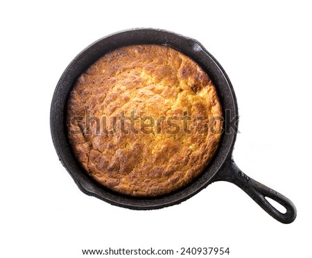 Home Style corn bread in a cast-iron skillet isolated on white. - stock photo