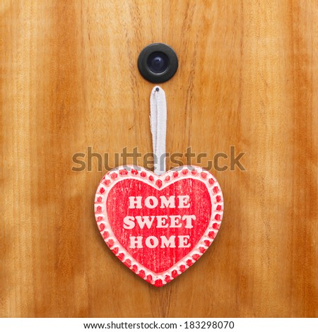Home sweet home heart on door - stock photo
