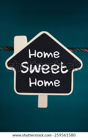 Home Sweet Home text on the wooden home sign - stock photo