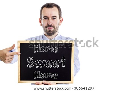 Home Sweet Home - Young businessman with blackboard - isolated on white