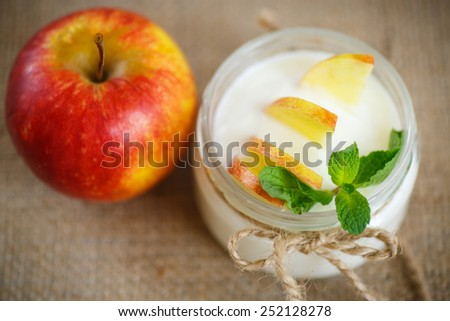 home sweet yogurt with apples on the table - stock photo