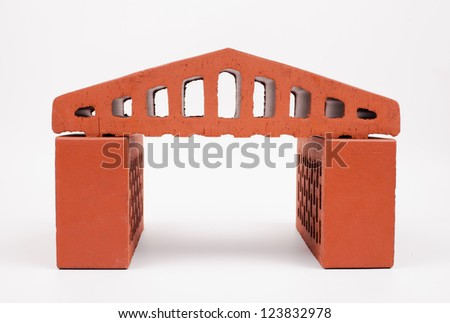 home symbol made from bricks isolated on white - stock photo