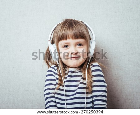 home, technology and music concept - little girl with headphones  - stock photo