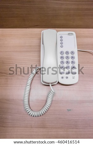 Home telephone with wooden background